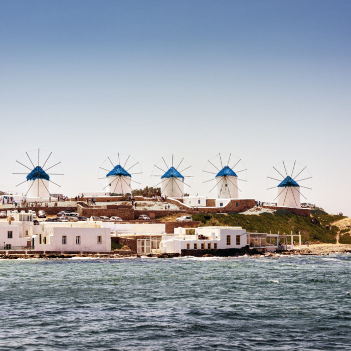 View of famous Myknos island windmills on the Aegean sea.